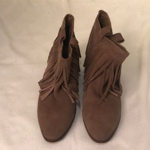 Tan booties with ruffle go around it very nice